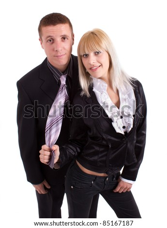 woman pulls tie worried man - stock photo