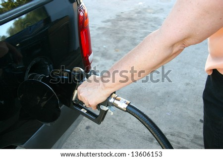 woman pumping gas