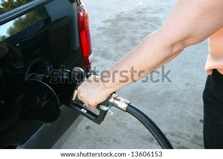 woman pumping gas - stock photo
