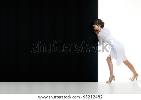 Woman push black billboard on empty white backgrounds.