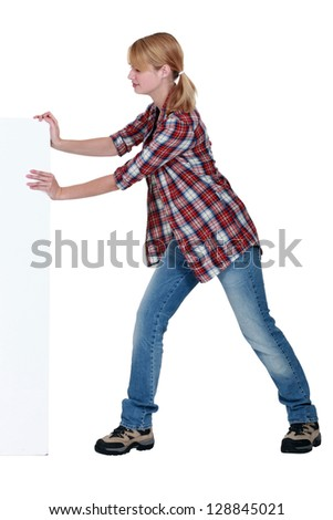 Woman pushing a blank sign - stock photo