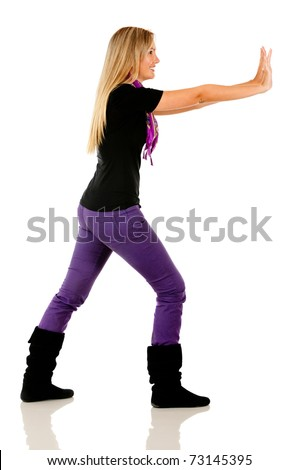 Woman pushing against the wall - isolated over a white background