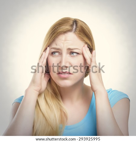 Woman puts hands on the head, toned photo. Concept of problems and headache. - stock photo