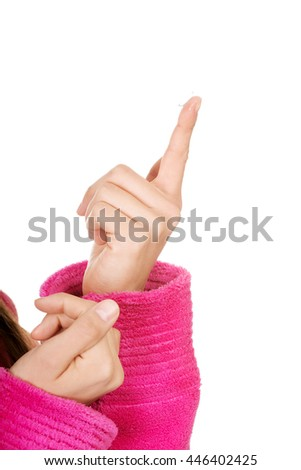 Woman putting contact lens in her eye. - stock photo