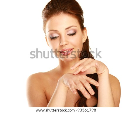 woman putting cream on her face Isolated on white background