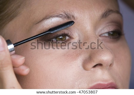 Woman putting on the makeup