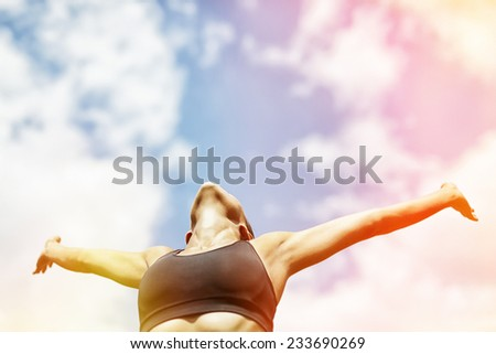 woman raised her arms and relaxing outdoors - stock photo