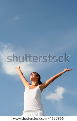 Woman raising arms above her head - stock photo