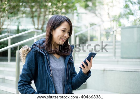 Woman read the text message on cellphone