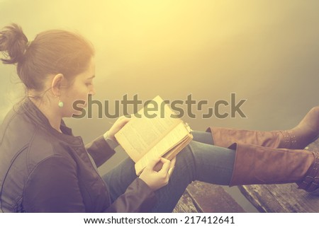 Woman reading a book - stock photo