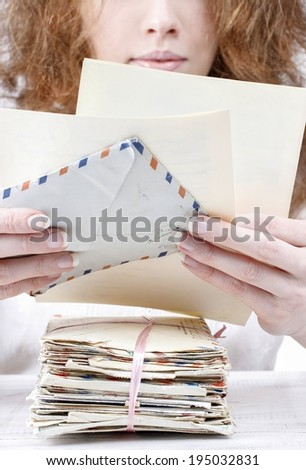 Woman reading a letter - stock photo
