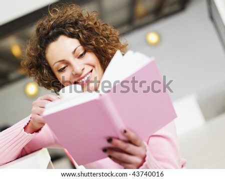 woman reading book at home and drinking coffee. Copy space - stock photo