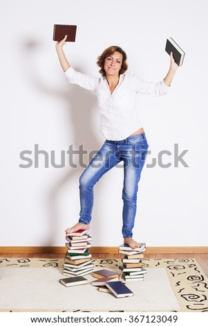 Woman reading books - stock photo