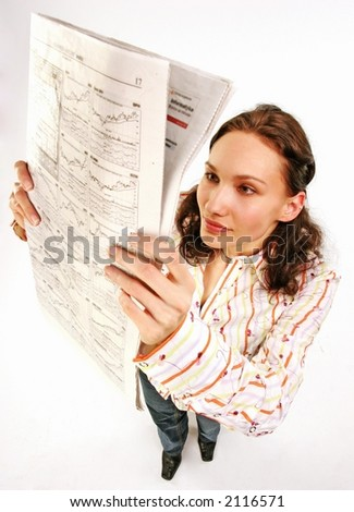 woman reading business statistics of a stock market - on white