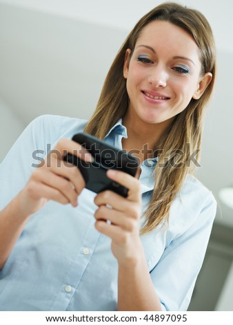 woman reading emails on mobile phone. Copy space