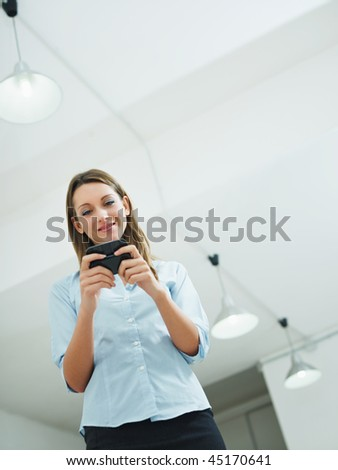 woman reading emails on mobile phone. Copy space - stock photo