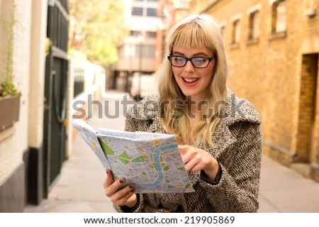 woman reading map - stock photo