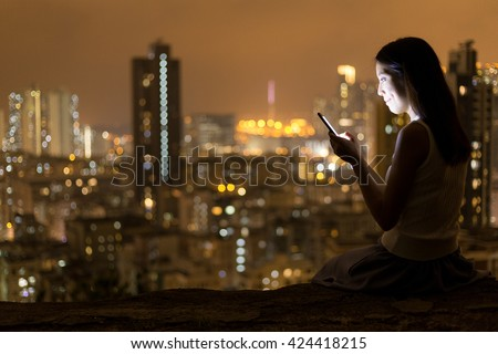 Woman reading on mobile phone