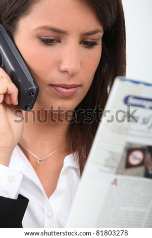 Woman reading on the phone - stock photo
