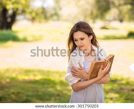 Woman reads book in park
