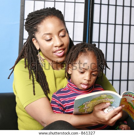 Woman reads to her little boy