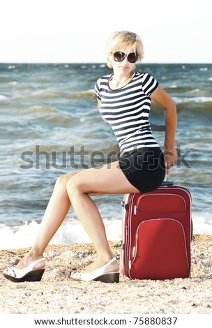 woman ready for traveling on sea resort - stock photo