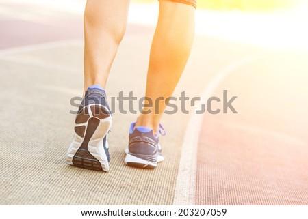 Woman Ready to Run on Track Lane - stock photo