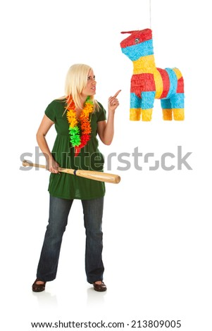 Woman Ready To Take On Pinata With Bat - stock photo