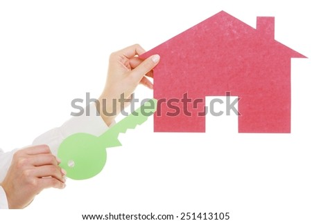 Woman real estate agent holding red paper house and key. Property business and accommodation or home buying ownership concept, isolated on white background - stock photo