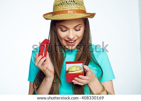 Woman received present gift box with cake. Take care of your calories and you will have a beautiful view. Food creative. - stock photo