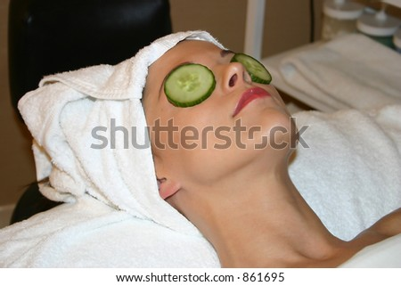 Woman Receives Facial at Spa - stock photo