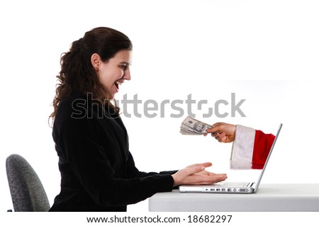 woman receiving a Christmas gift by internet via Santa - stock photo