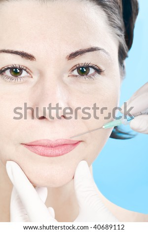 woman receiving a injection - stock photo