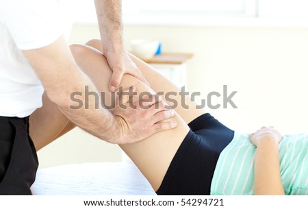 Woman receiving a massage in a health club