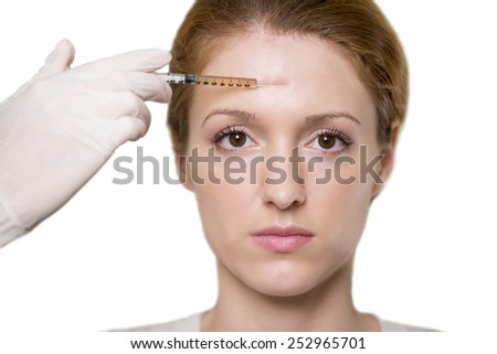 Woman receiving an injection - stock photo