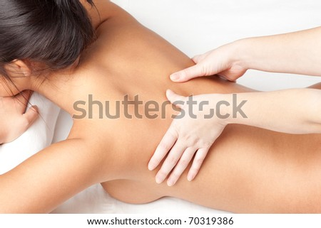 woman receiving back massage over white - stock photo