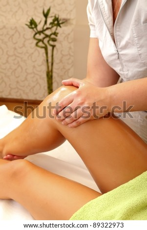 Woman receiving foot massage in a salon