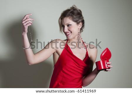 Woman receiving gift - stock photo