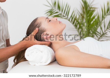 Woman receiving neck massage in medical office