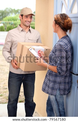 Woman receiving shipment at home - stock photo