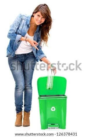 Woman recycling a plastic bottle - isolated over a white background - stock photo