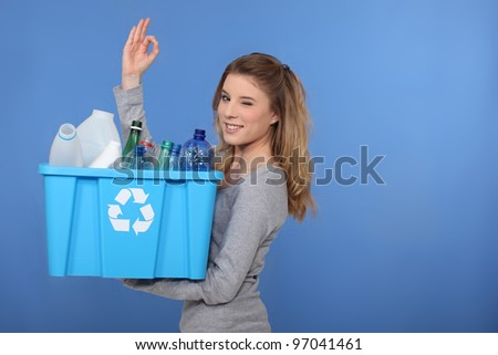 Woman recycling plastic bottles - stock photo