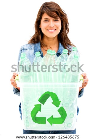 Woman recycling plastic bottles in a bin - isolated over white - stock photo