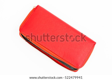 Woman red purse isolated on the white background. Closeup of modern red leather wallet over white background. Top view on the wallet.