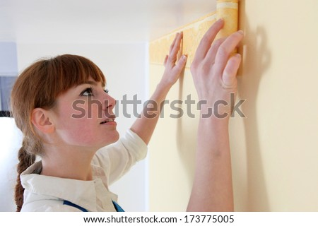 Woman redecorating her home - stock photo