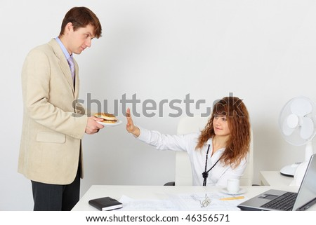 Woman refuses to eat because is on a diet - stock photo