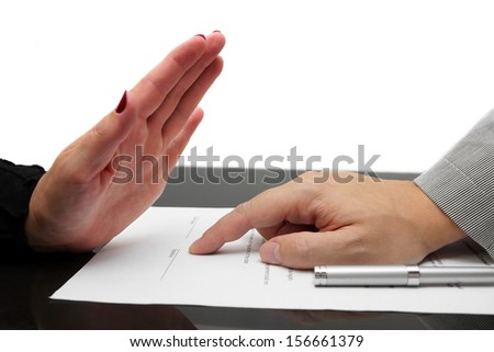woman refusing to sign contract or divorce - stock photo