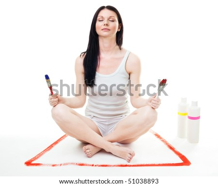 Woman relax after paint work sitting in yoga meditation pose with brushes - stock photo