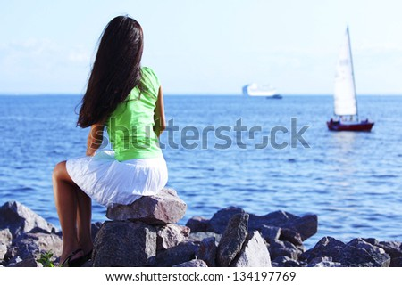 woman relax blue sea and ship on background - stock photo