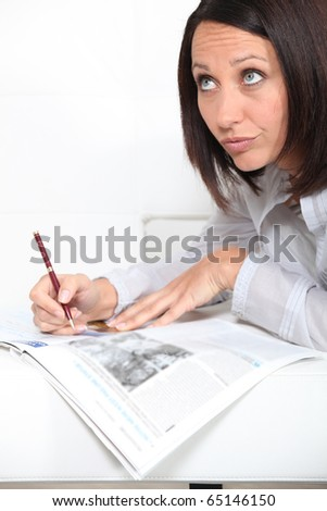 Woman relaxed in front of a magazine - stock photo